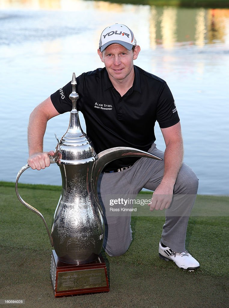 <a gi-track='captionPersonalityLinkClicked' href=/galleries/search?phrase=Stephen+Gallacher&family=editorial&specificpeople=215277 ng-click='$event.stopPropagation()'>Stephen Gallacher</a> of Scotland with the winners trophy after the final round of the Omega Dubai Desert Classic on February 3, 2013 in Dubai, United Arab Emirates.