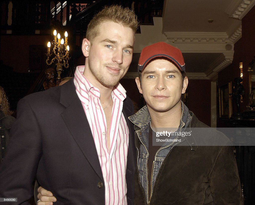 Stephen Gately (R) and boyfriend Andy Cowles attend the Boyzone Reunion at Palmerstown stud golf club April 20, 2004 in Dublin Ireland. The boys met up at Citywest Hotel to officially launch the 3rd annual celebrity golf classic in aid of the Irish Autism Alliance.