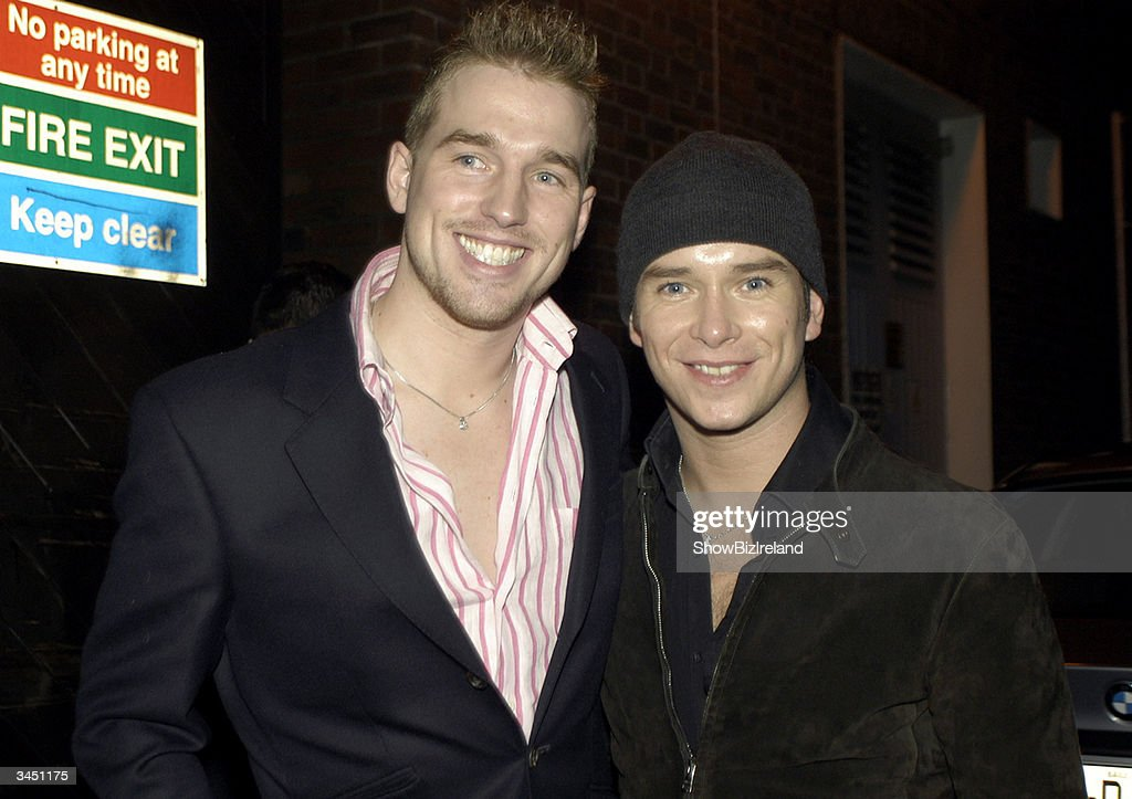 Stephen Gately (R) and his partner Andy Cowles stand outside Diep Shaker Restaurant April 20, 2004 in Dublin, Ireland.