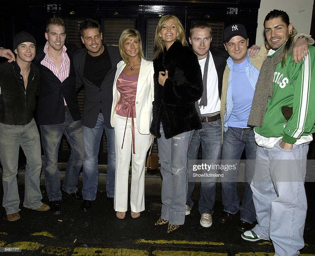 Stephen Gately and his partner Andy Cowles stand with Keith and Lisa Duffy, Yvonne and Ronan Keating, Mikey Graham and Shane Lynch outside Diep Shaker Restaurant April 20, 2004 in Dublin, Ireland.