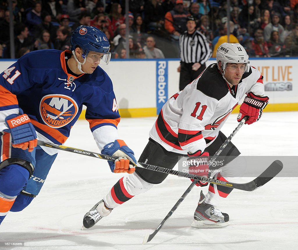 Stephen Gionta #11 of the New Jersey Devils faces off against David Ullstrom #41 of the New York Islanders during the game on February 16, 2013 at Nassau Veterans Memorial Coliseum in Uniondale, New York.