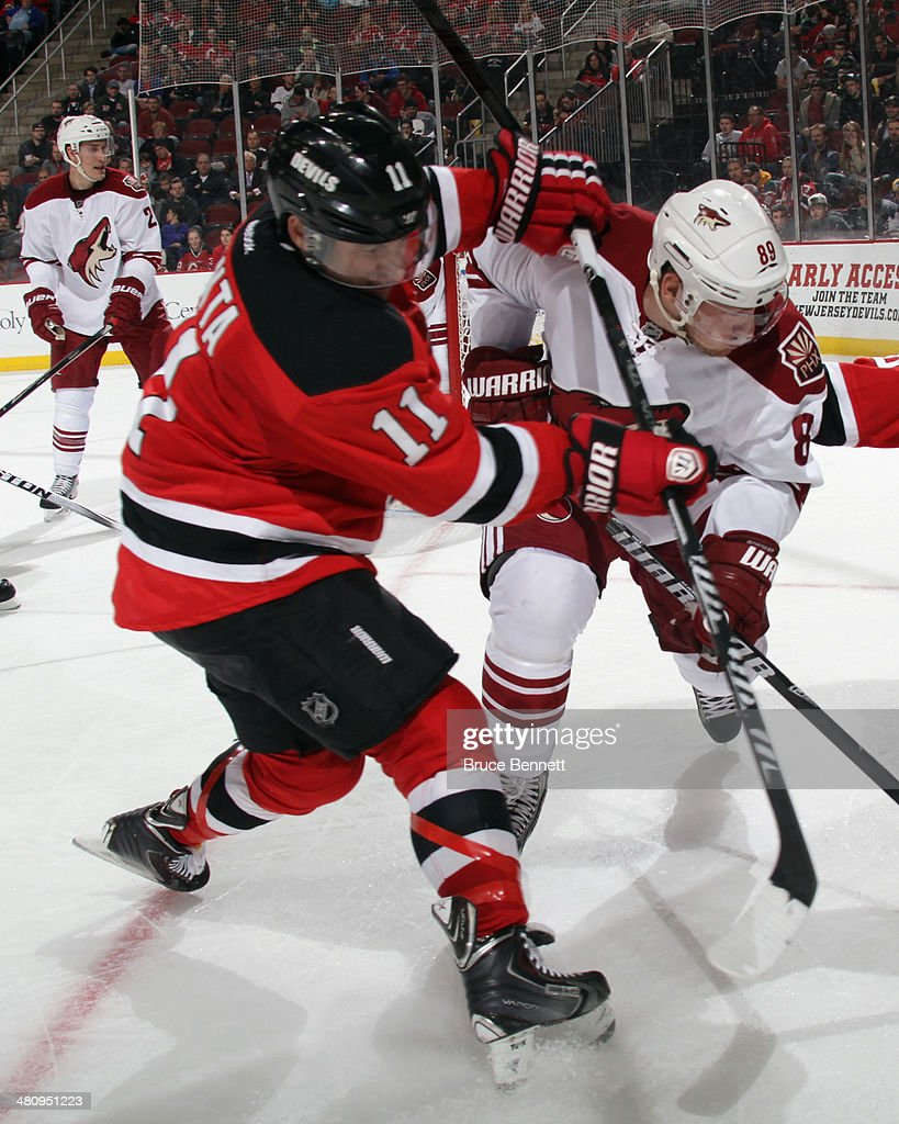 <a gi-track='captionPersonalityLinkClicked' href=/galleries/search?phrase=Stephen+Gionta&family=editorial&specificpeople=817969 ng-click='$event.stopPropagation()'>Stephen Gionta</a> #11 of the New Jersey Devils gets the stick up on <a gi-track='captionPersonalityLinkClicked' href=/galleries/search?phrase=Mikkel+Boedker&family=editorial&specificpeople=4697252 ng-click='$event.stopPropagation()'>Mikkel Boedker</a> #89 of the Phoenix Coyotes during the second period at the Prudential Center on March 27, 2014 in Newark, New Jersey.