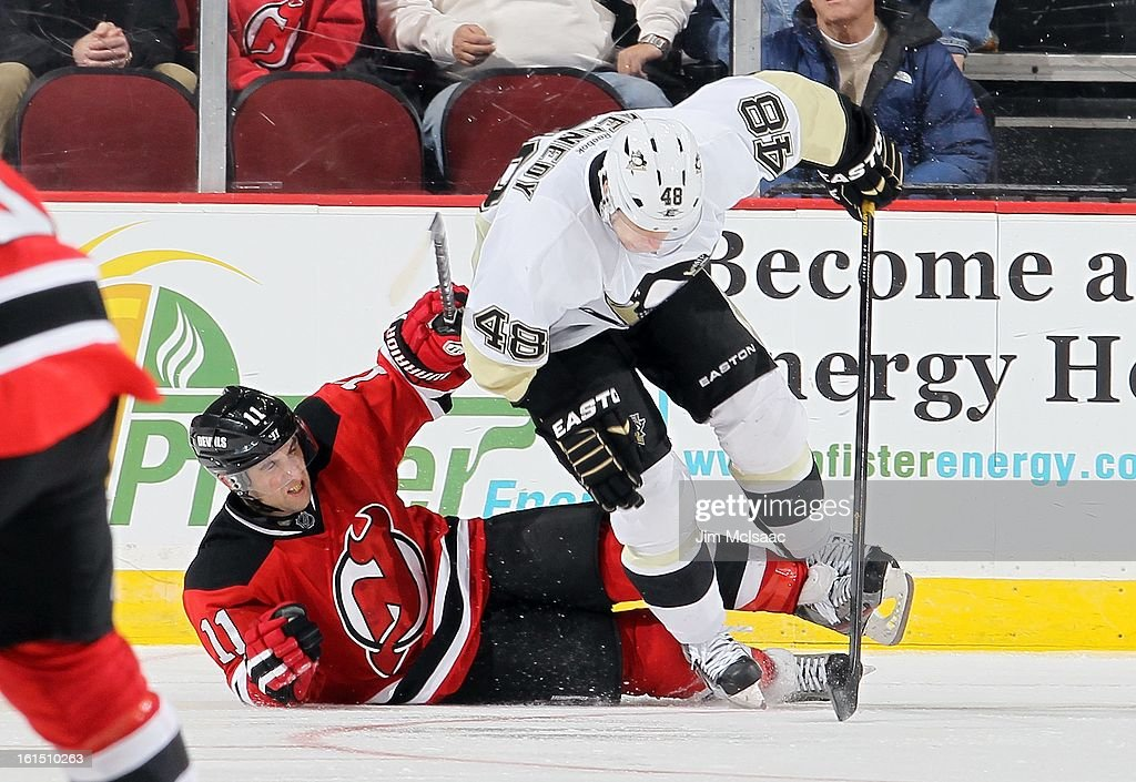 Stephen Gionta #11 of the New Jersey Devils in action against Tyler Kennedy #48 of the Pittsburgh Penguins at the Prudential Center on February 9, 2013 in Newark, New Jersey. The Devils defeated the Penguins 3-1.