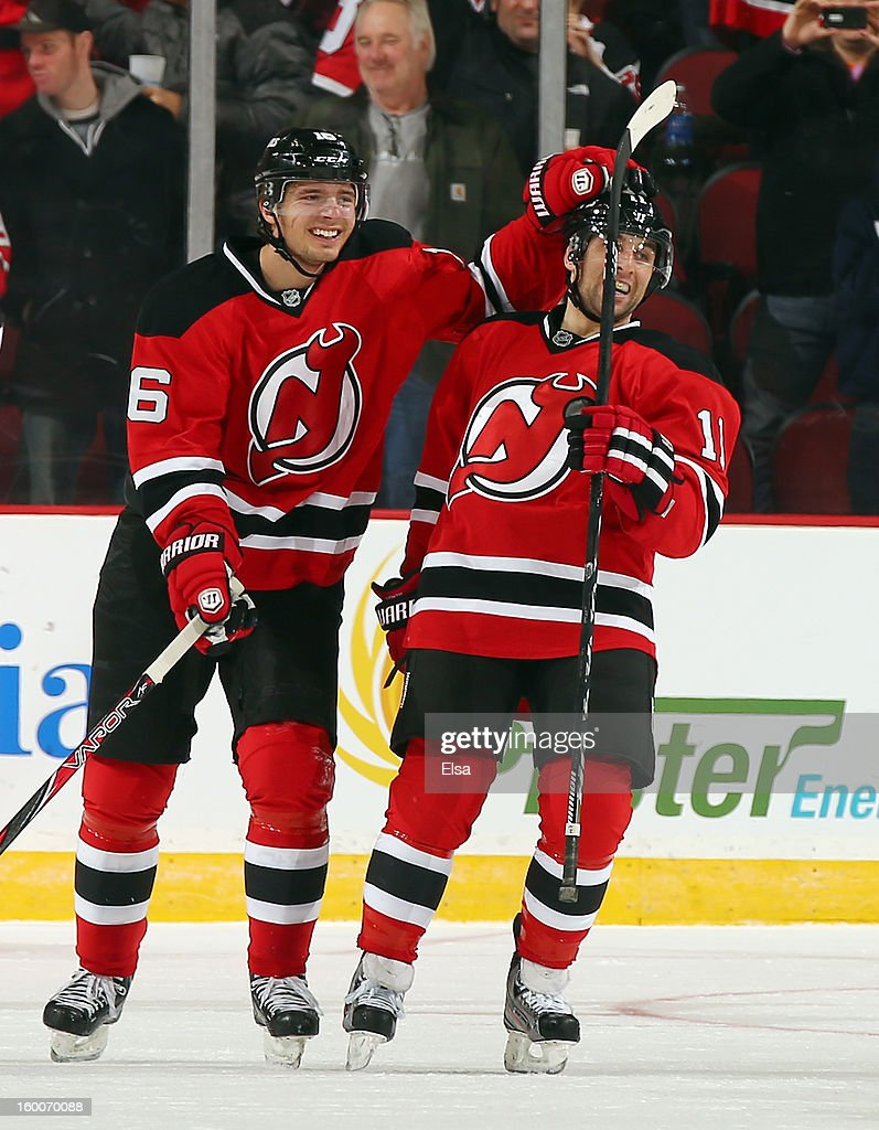 Stephen Gionta #11 of the New Jersey Devils is congratulated by teammate Jacob Josefson #16 after Gionta scored in the first period against the Washington Capitals at the Prudential Center on January 25, 2013 in Newark, New Jersey.