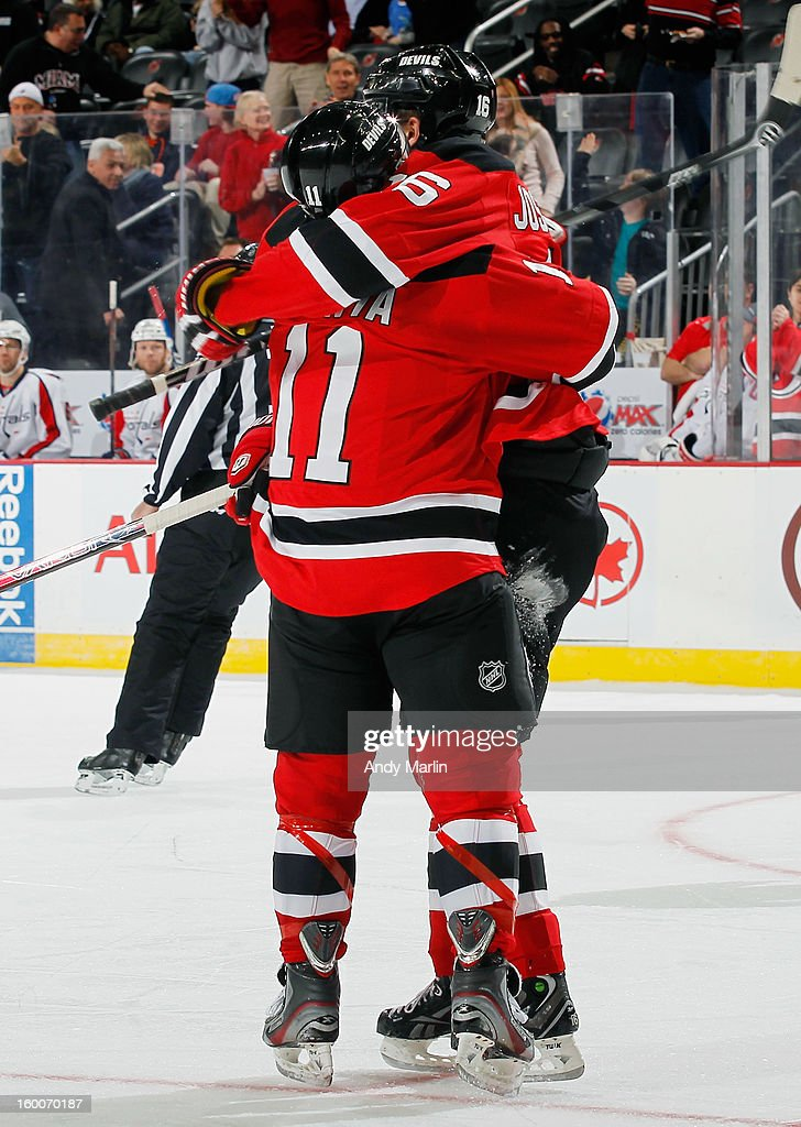 Stephen Gionta #11 of the New Jersey Devils is congratulated by teammate Jacob Josefson #16 after scoring a first-period goal against the Washington Capitals during the game at the Prudential Center on January 25, 2013 in Newark, New Jersey.