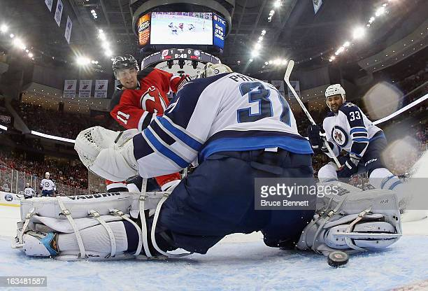 Stephen Gionta of the New Jersey Devils scores at 1012 of the first period against Ondrej Pavelec of the Winnipeg Jets at the Prudential Center on...