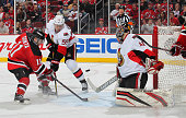 Stephen Gionta of the New Jersey Devils scores the winning goal his first NHL goal against Craig Anderson of the Ottawa Senators during the game at...