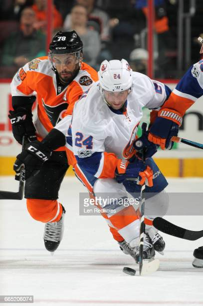 Stephen Gionta of the New York Islanders skates the puck against PierreEdouard Bellemare of the Philadelphia Flyers on March 30 2017 at the Wells...