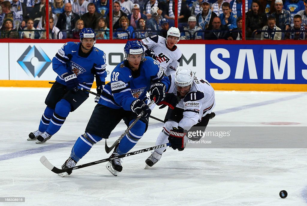 <a gi-track='captionPersonalityLinkClicked' href=/galleries/search?phrase=Stephen+Gionta&family=editorial&specificpeople=817969 ng-click='$event.stopPropagation()'>Stephen Gionta</a> (R) of USA and Juuso Hietanen (L) of Finland battle for the puck during the IIHF World Championship group H match between USA and Finland at Hartwall Areena on May 8, 2013 in Helsinki, Finland.