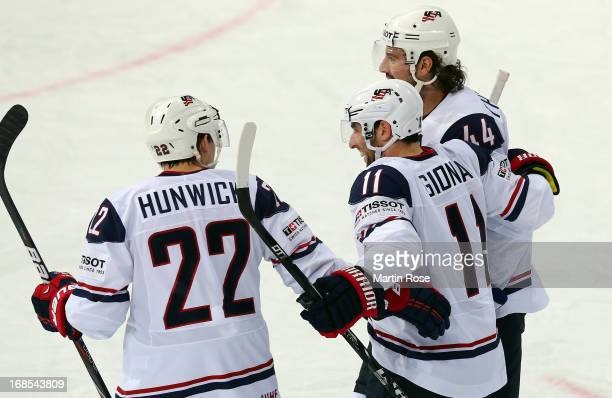 Stephen Gionta of USA celebrate with his team mates after he scores his team's 1st goal during the IIHF World Championship group H match between USA...