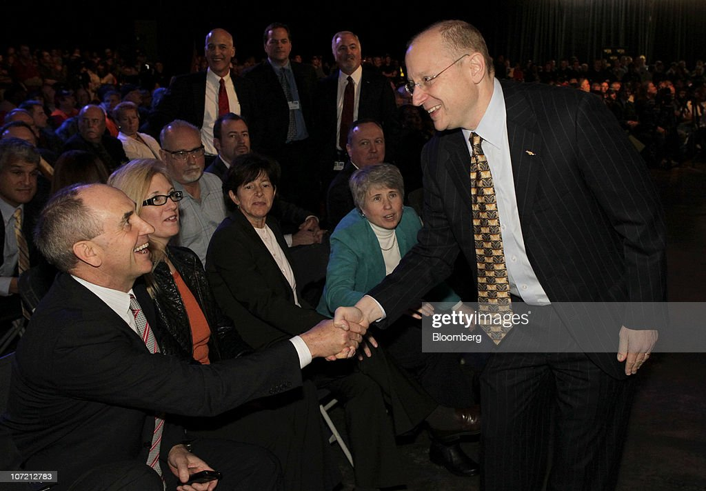 Stephen Girsky, vice chairman at General Motors Co., right, shakes hands with Chris Liddell, GM's vice chairman and chief financial officer, during an event at the Detroit-Hamtramck Assembly plant in Detroit, Michigan, U.S., on Tuesday, Nov. 30, 2010. General Motors Co., the maker of the Chevrolet Volt gasoline-electric car, will hire 1,000 engineers in Michigan to help expand the automakers' lineup of electric-drive vehicles. Photographer: Jeff Kowalsky/Bloomberg via Getty Images