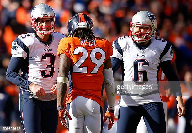 Stephen Gostkowski and Ryan Allen of the New England Patriots look on after a missed extra point in the first quarter against the Denver Broncos in...