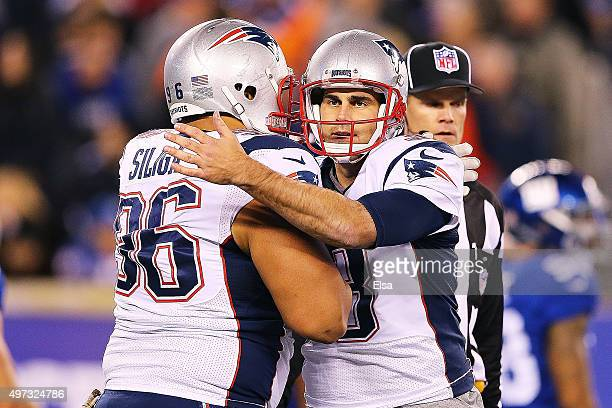 Stephen Gostkowski of the New England Patriots is congratulated by his teammate Sealver Siliga after kicking an point after try against the New York...