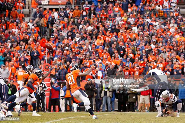 Stephen Gostkowski of the New England Patriots kicks a 38yard field goal held by Ryan Allen in the third quarter against the Denver Broncos in the...