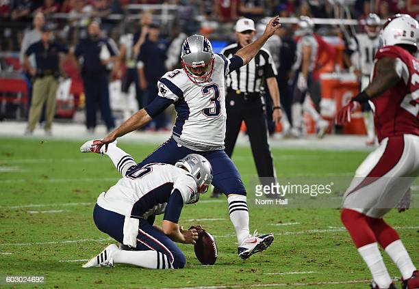 Stephen Gostkowski of the New England Patriots kicks a 47 yard field goal out of a hold by teammate Ryan Allen against the Arizona Cardinals at...
