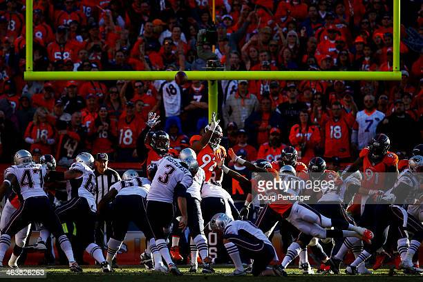 Stephen Gostkowski of the New England Patriots kicks an extra point in the fourth quarter against the Denver Broncos during the AFC Championship game...