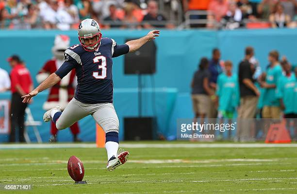 Stephen Gostkowski of the New England Patriots kicks off during a game against the Miami Dolphins at Sun Life Stadium on December 15 2013 in Miami...