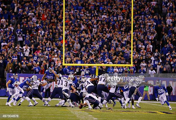 Stephen Gostkowski of the New England Patriots kicks the game winning field goal against the New York Giants in the final seconds of the game giving...