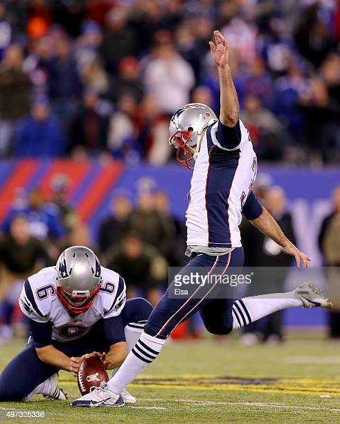 Stephen Gostkowski of the New England Patriots kicks the game winning field goal in the final minute of the game as Ryan Allen holds to give them the...
