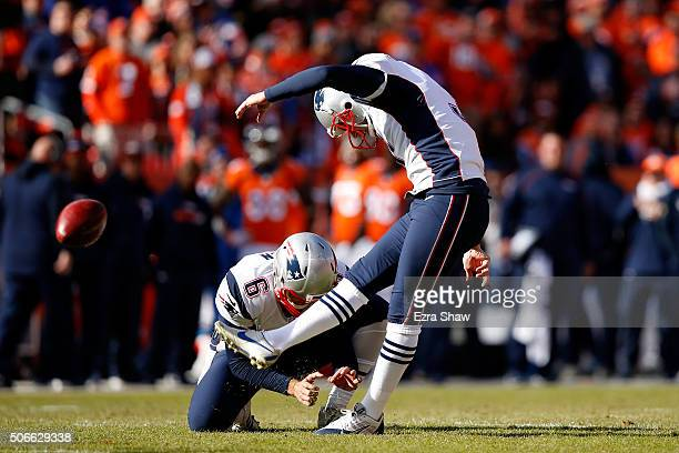 Stephen Gostkowski of the New England Patriots misses an extra point in the first quarter held by Ryan Allen against the Denver Broncos in the AFC...