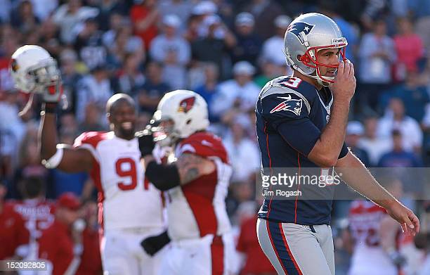 Stephen Gostkowski of the New England Patriots reacts after missing a field goal in the fourth quarter as the Arizona Cardinals celebrate at Gillette...