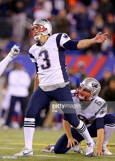 Stephen Gostkowski of the New England Patriots watches his game winning field goal in the final minute of the game as Ryan Allen looks on to give the...