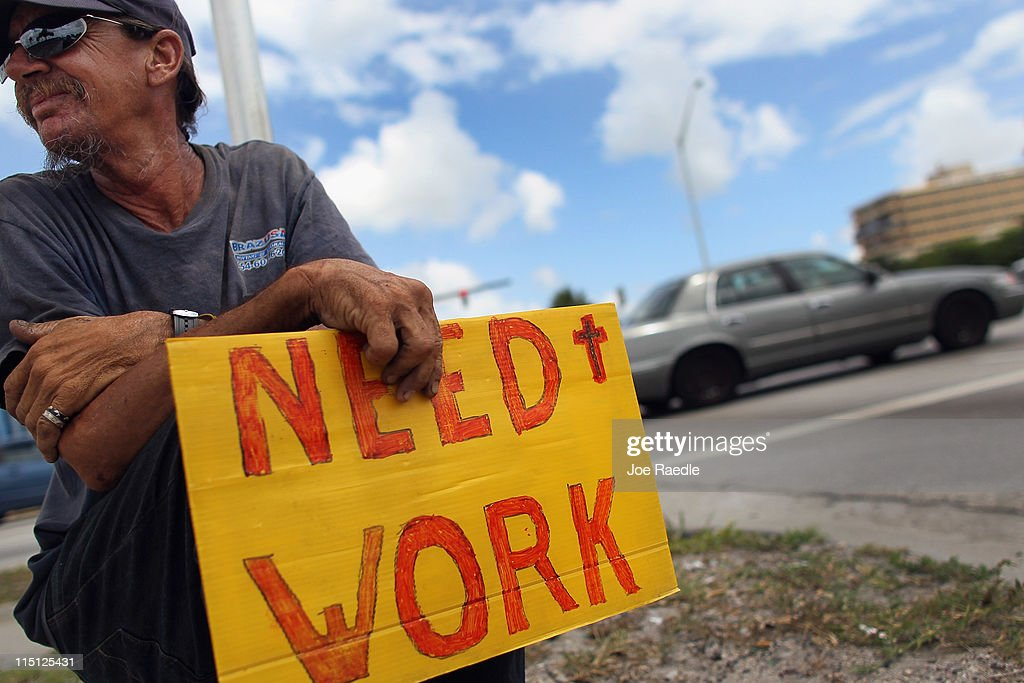 Stephen Greene works a street corner hoping to land a job as a laborer or carpenter on June 3, 2011 in Pompano Beach, Florida. Employers in May added 54,000 jobs, the fewest in eight months, and the unemployment rate inched up to 9.1 percent.