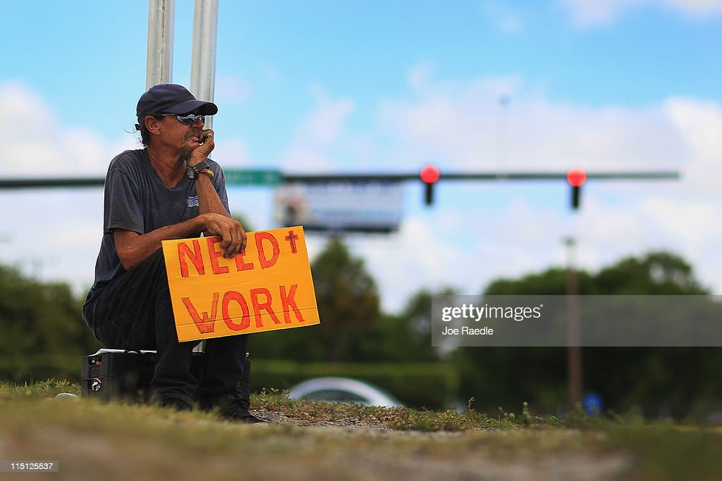 Stephen Greene works a street corner hoping to land a job as a laborer or carpenter on June 3, 2011 in Pompano Beach, Florida. Employers in May added 54,000 jobs the fewest in eight months, and the unemployment rate inched up to 9.1 percent.