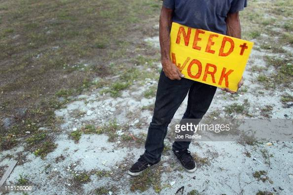Stephen Greene works a street corner hoping to land a job as a laborer or carpenter on June 3 2011 in Pompano Beach Florida Employers in May added...