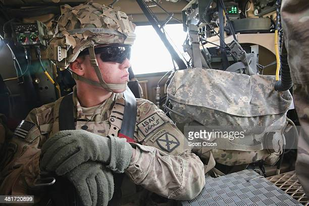Stephen Han from Gilbert Arizona with the US Army's 2nd Battalion 87th Infantry Regiment 3rd Brigade Combat Team 10th Mountain Division heads out on...
