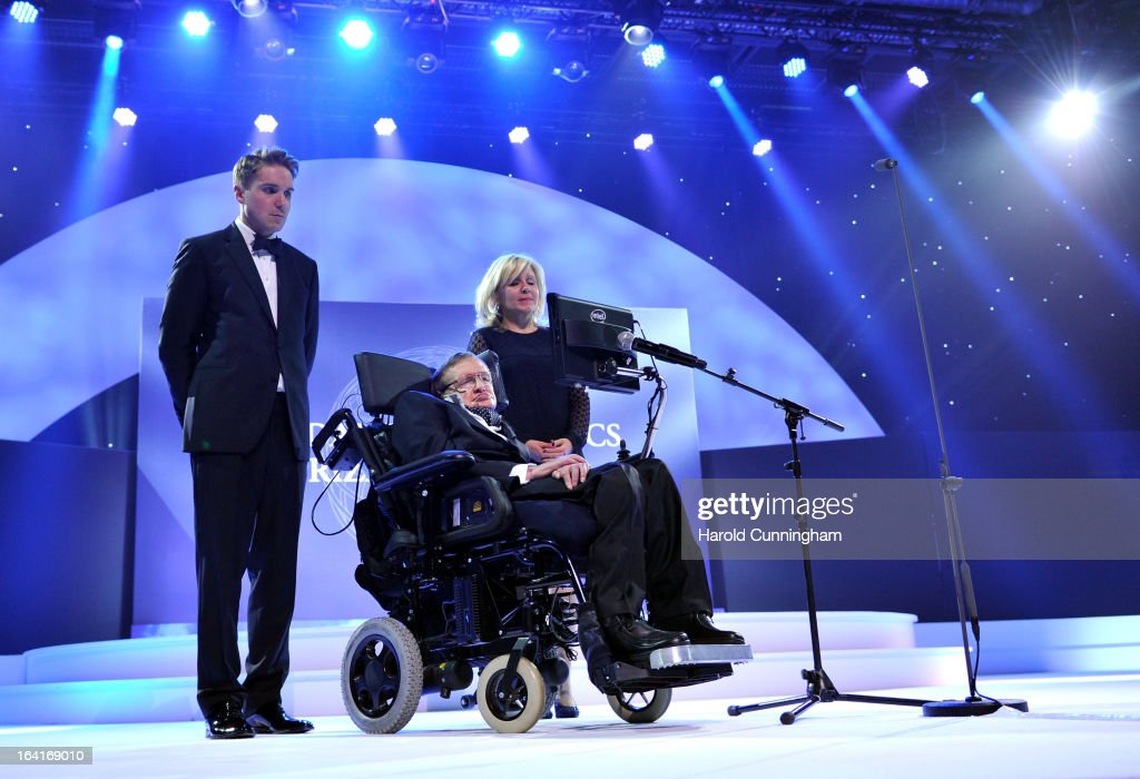 <a gi-track='captionPersonalityLinkClicked' href=/galleries/search?phrase=Stephen+Hawking&family=editorial&specificpeople=215281 ng-click='$event.stopPropagation()'>Stephen Hawking</a> (C), laureates of 2013 Physics Frontiers Prize, delivers a speech as his daughter <a gi-track='captionPersonalityLinkClicked' href=/galleries/search?phrase=Lucy+Hawking&family=editorial&specificpeople=583093 ng-click='$event.stopPropagation()'>Lucy Hawking</a> (R) looks on during the Fundamental Physics Prize Foundation Inaugural Prize Ceremony at the CICG on March 20, 2013 in Geneva, Switzerland. The prize is today the most financially lucrative scientific prize in the world, with its nine Inaugural recipients to receive 27 million USD collectively, providing them more freedom and opportunity to pursue future accomplishment. Led by a not-for-profit corporation, the Fundamental Physics Prize Foundation dedicates itself to advance the knowledge of the Universe at the deepest level.