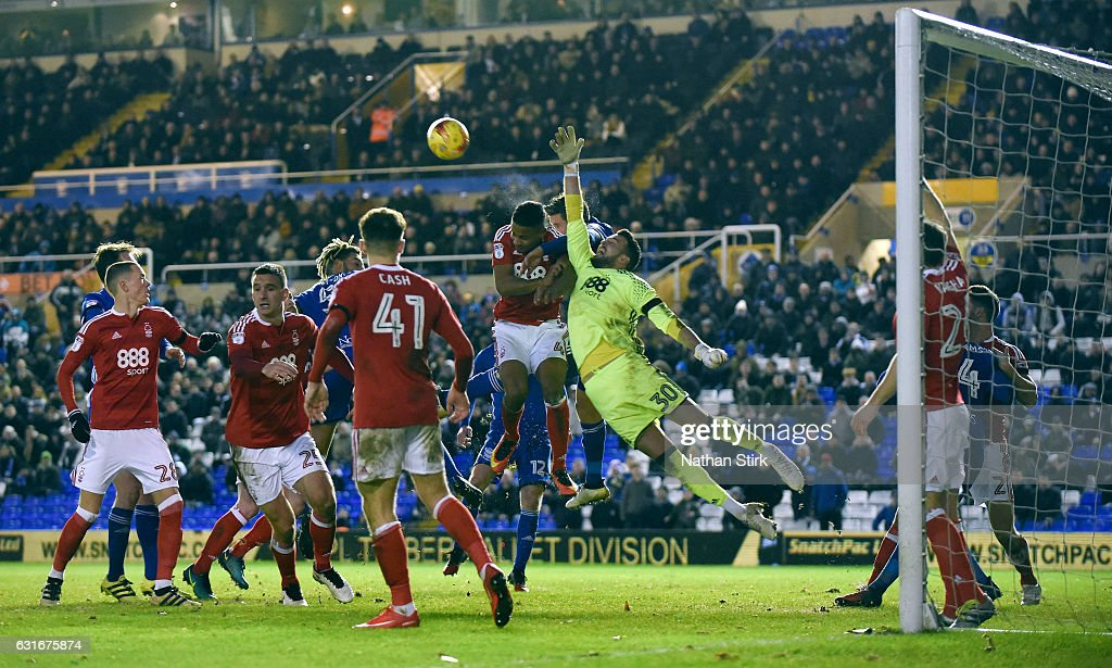 Stephen Henderson goakeeper of Nottingham Forest and Lukas Jutkiewicz of Birmingham compete for the ball during the Sky Bet Championship match between Birmingham City and Nottingham Forest at St Andrews Stadium on January 14, 2017 in Birmingham, England (Photo by Nathan Stirk/Getty Images).