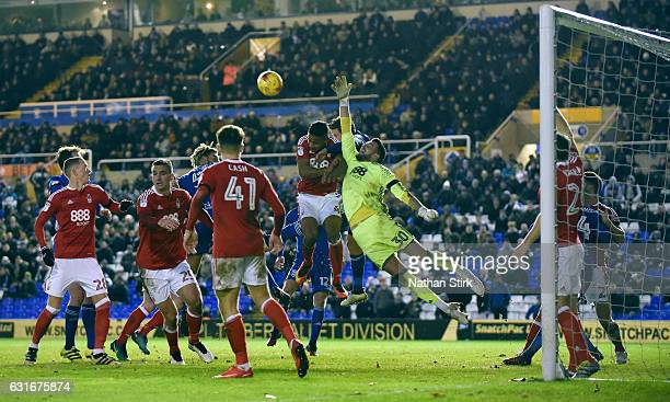 Stephen Henderson goakeeper of Nottingham Forest and Lukas Jutkiewicz of Birmingham compete for the ball during the Sky Bet Championship match...
