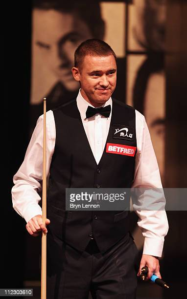 Stephen Hendry of Scotland arrives for the second session of his game against Joe Perry of England in his round one game on day three of the...