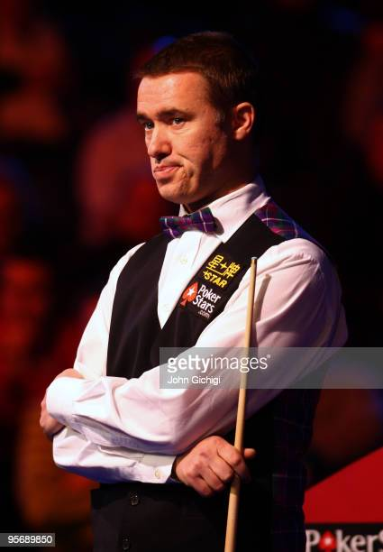 Stephen Hendry of Scotland contemplates his next shot in his second round match against Shaun Murphy of England during the PokerStarcom Masters...