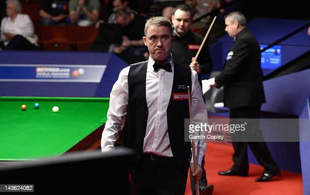 Stephen Hendry of Scotland leaves the table after the first session of his quarter final match against Stephen Maguire of Scotland during the...