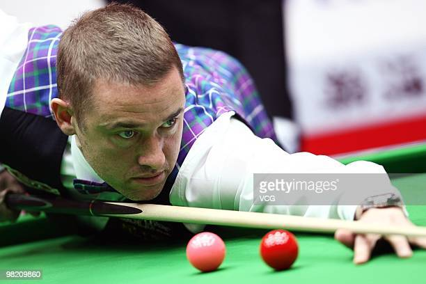 Stephen Hendry of Scotland lines up a shot during his match against Mark Allen of Northern Ireland during the 5th day of the 2010 World Snooker China...