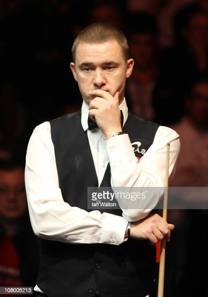 Stephen Hendry of Scotland looks on during his match against Neil Robertson of Australia in Round One of The Ladbrokesmobile Masters on Day 4 at...
