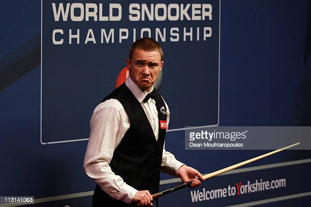 Stephen Hendry of Scotland looks to play a shot in the round two game against Mark Selby of England on day nine of the Betfredcom World Snooker...