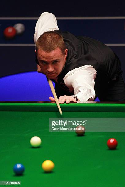 Stephen Hendry of Scotland plays a shot in the round two game against Mark Selby of England on day nine of the Betfredcom World Snooker Championship...