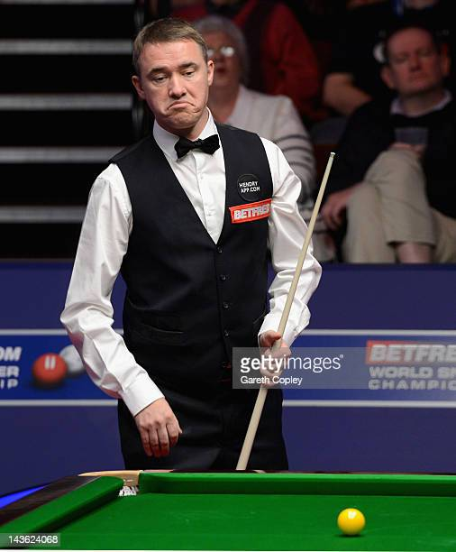 Stephen Hendry of Scotland reacts in his quarter final match against Stephen Maguire of Scotland during the Betfredcom World Snooker Championship at...