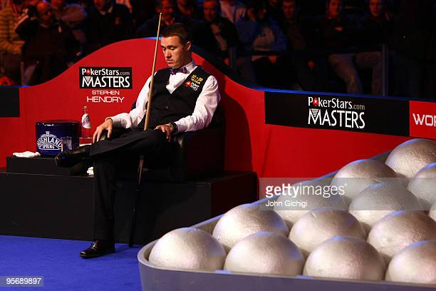 Stephen Hendry of Scotland sits dejected in his second round match against Shaun Murphy during the PokerStarcom Masters snooker tournament at Wembley...