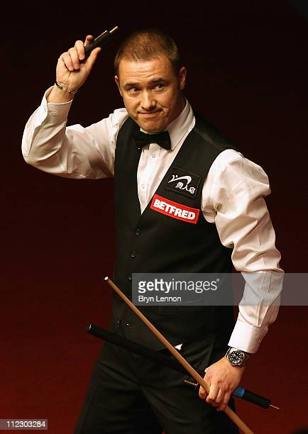 Stephen Hendry of Scotland waves after beating Joe Perry of England in his round one game on day three of the Betfredcom World Snooker Championship...