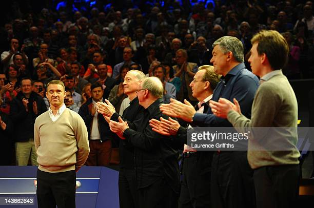 Stephen Hendry of Scotland waves goodbye to snooker in front of Ex World Champions Steve Davis Dennis Taylor Terry Griffiths John Parrott and Ken...