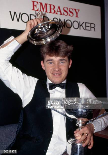 Stephen Hendry of Scotland with the trophy after defeating Jimmy White 185 in the World Snooker Championship Final at the Crucible in Sheffield on...
