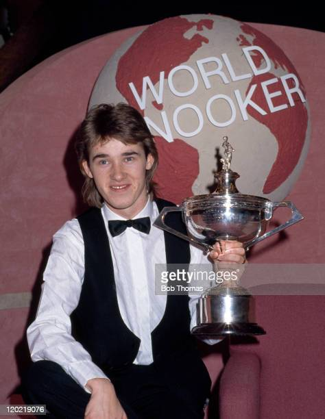 Stephen Hendry of Scotland with the trophy after defeating Jimmy White 1812 in the World Snooker Championship Final at the Crucible in Sheffield on...