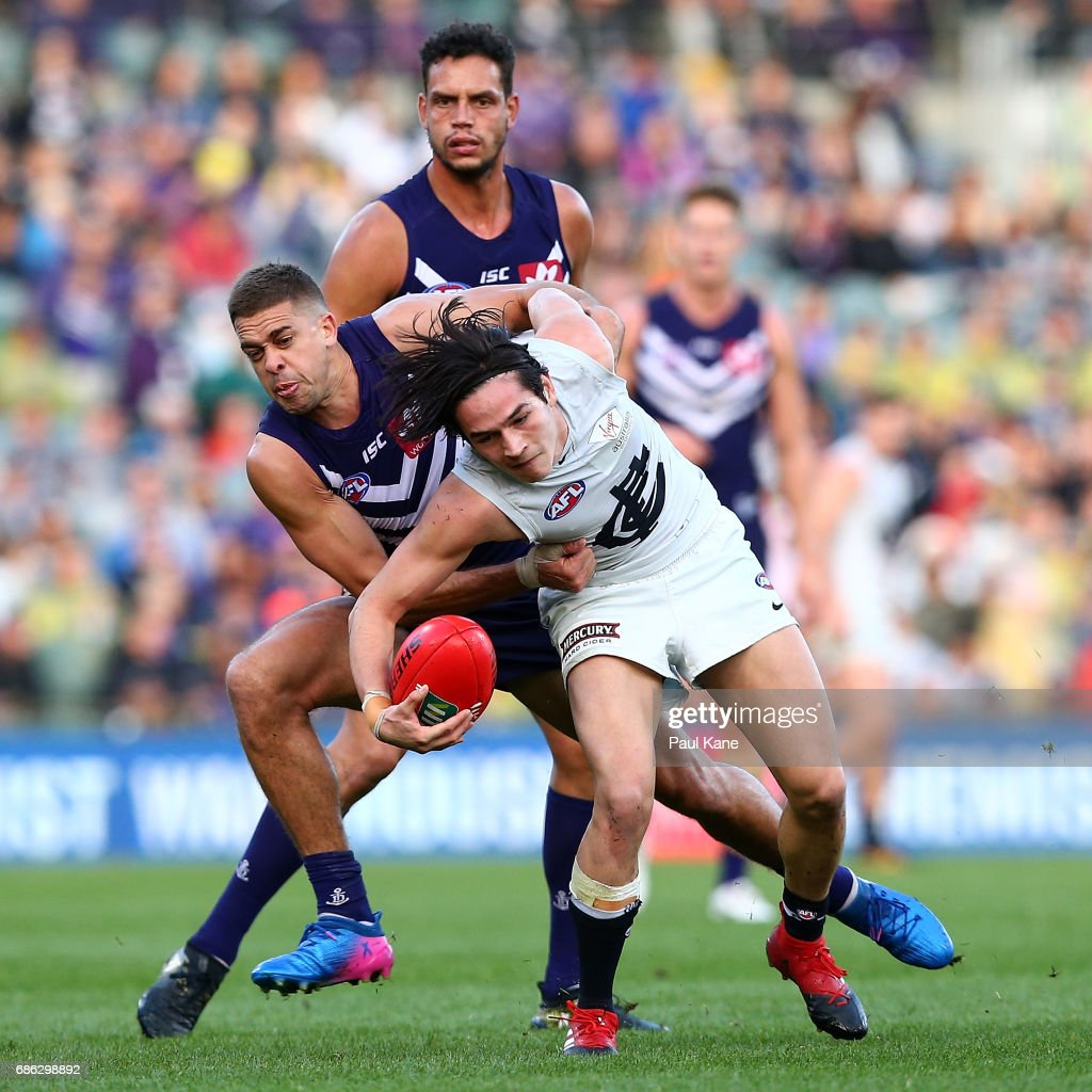 Stephen Hill of the Dockers tackles Zac Fisher of the Blues during the round nine AFL match between the Fremantle Dockers and the Carlton Blues at Domain Stadium on May 21, 2017 in Perth, Australia.