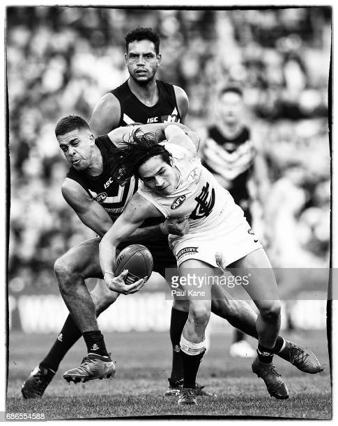 Stephen Hill of the Dockers tackles Zac Fisher of the Blues during the round nine AFL match between the Fremantle Dockers and the Carlton Blues at...