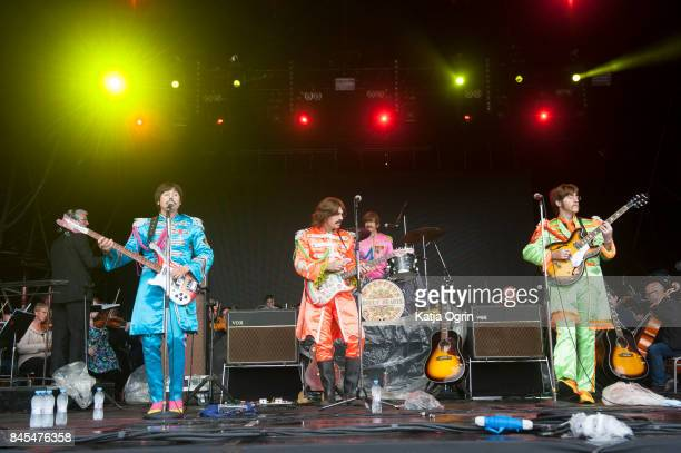 Stephen Hill Steven White Gordon Elsmore and Adam Hastings of The Bootleg Beatles perform with The Royal Liverpool Philharmonic Orchestra to...