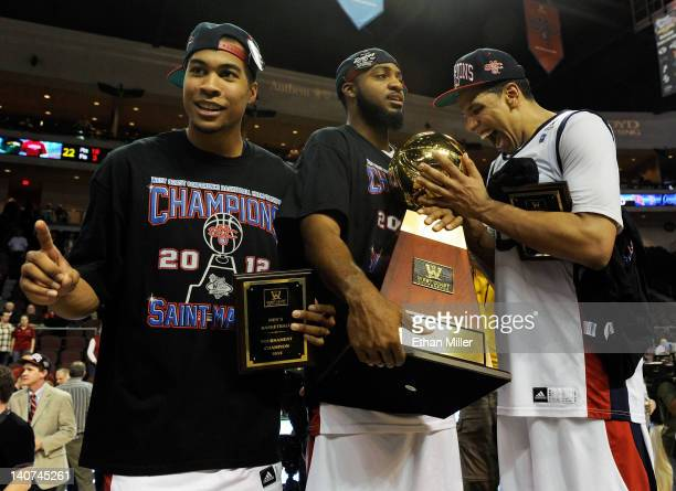 Stephen Holt Kenton Walker II and Brad Waldow of the Saint Mary's Gaels celebrate with the trophy after defeating the Gonzaga Bulldogs 7874 in...